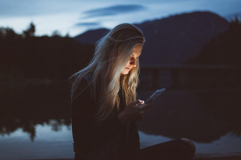 girl looking at social media content at night